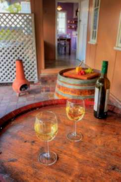 Enjoy a glass of wine at James Farmhouse Accommodation